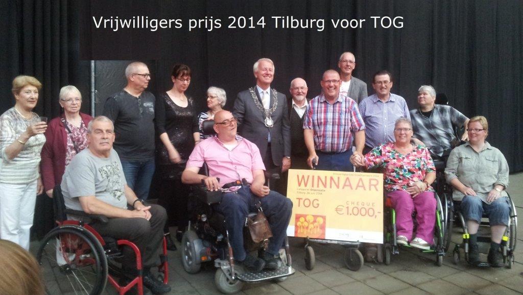 Vrijwilligers van het TOG samen met de burgemeester